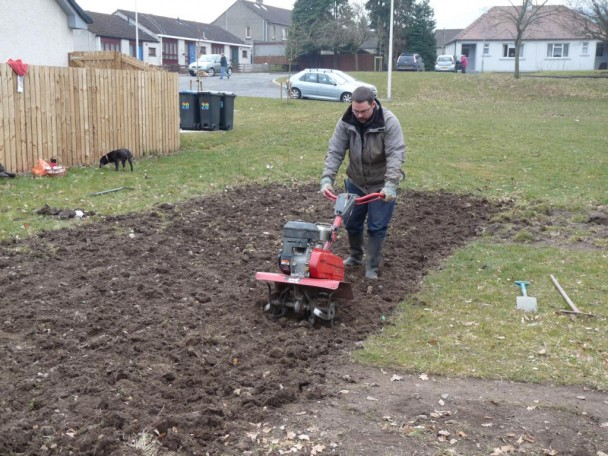 Rab rotavating the soil