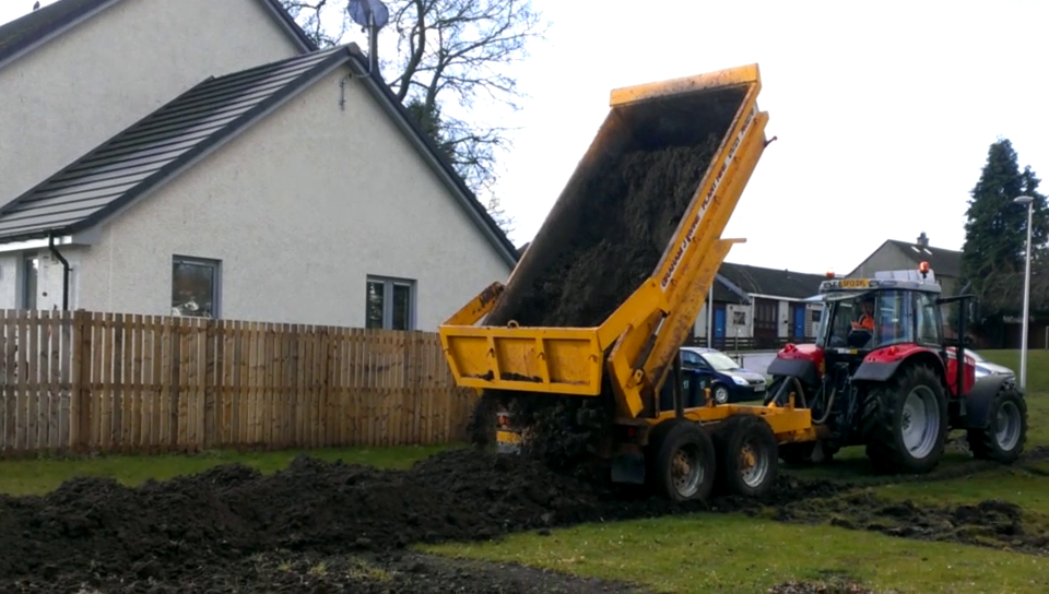 Pouring the topsoil